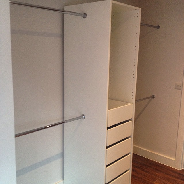 Ikea Pax semi-fitted installation with external clothes rails. #ikeahack #ikea #assembly #Sussex